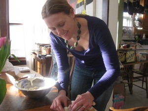 "Erin Piorier, Midwife and Herbalist, Owner of Blue Vervain Botanicals making a batch of ""Botanical Eye Cream"""